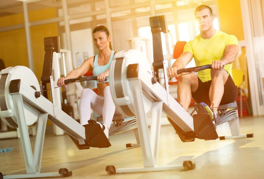 A boy and girl doing workouts in gym